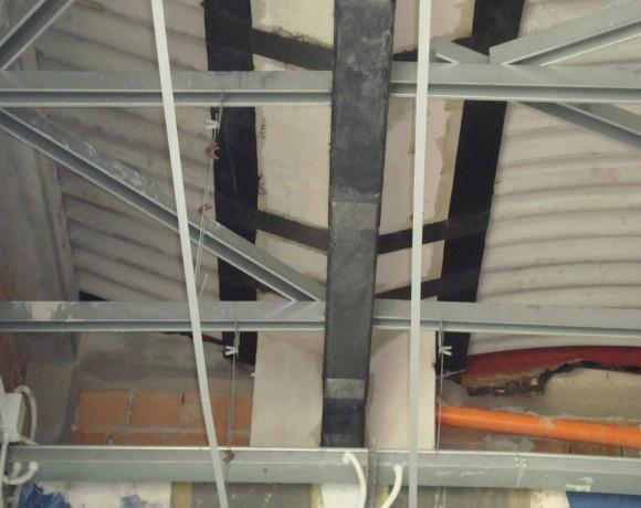 Rinforzo strutturale con miglioramento sismico di travi di copertura in cls